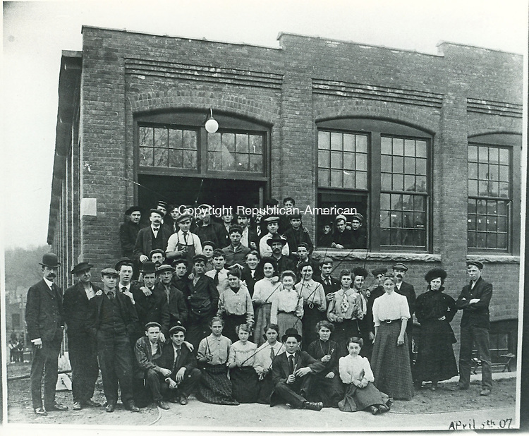 Workers at Union Tubular Company displaying fishing rods manufactured in Torrington, 1907