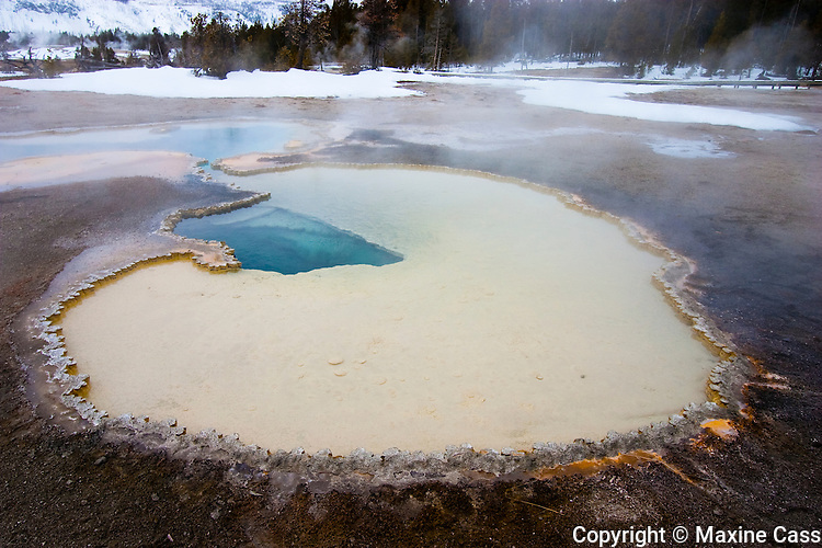 Heart-shaped geyser hole, a geothermal feature. Winter in Old Faithful Geyser Basin, Yellowstone National Park, Wyoming, United States of America