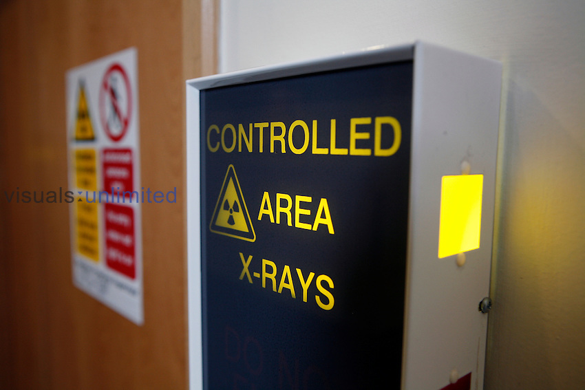 X-ray warning sign. View of an x-ray warning sign, warning the reader that they are about to pass into a controlled area where there is a danger of x-ray exopsure. Royalty Free