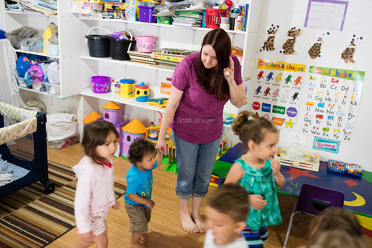 Lora Reyes is a licensed family childcare educator in Westfield, Mass., where she operates the daycare Lora's Little Ones out of her home on Thurs., June 2, 2016. Today she was in charge of 7 children, aged 14 months to 5 years old, handling meals, playtime, and educational activities throughout the day, starting about 7am and going until 4:30pm. She uses the Mother Goose Time curriculum throughout the day. Reyes is currently pursuing an undergraduate degree in Psychology at Holyoke Community College. She started 2 years ago after earning a Child Development Associate certification.