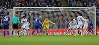 Pictured: Lukasz Fabianski of Swansea City (C) concedes a goal by Wes Morgan of Leicester City Saturday 27 August 2016<br />