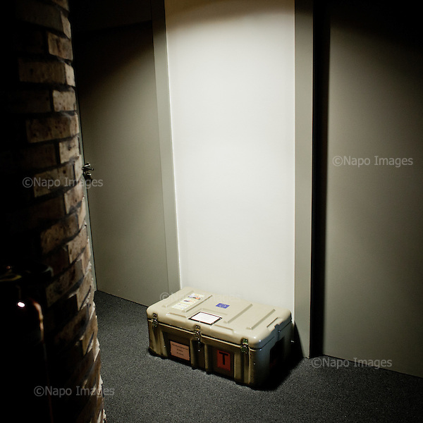 """STRASBOURG, FRANCE, NOVEMBER 24, 2014: At the European Parliament, individual containers called """"cantines"""", in which the documents are transported between European sites in Brussels, Strasbourg and Luxembourg, sit by the office door, waiting  for their owners to arrive. Every month thousands of parliament's employees travel back and forth between the towns. (Photo by Piotr Malecki / Napo Images)  STRASBURG, FRANCJA, 24/11/2014: Pod drzwiami biur w siedzibie Parlamentu Europejskiego leza indywidualne walizki uzywane do transportowania dokumentow pomiedzy siedzibami PE w Brukseli, Strasburgu i Luksemburgu. Kazdego miesiaca tysiace pracownikow parlamentu podrozuje miedzy siedzibami w Brukseli, Strasburgu i Luksemburgu. Fot: Piotr Malecki / Napo Images"""