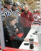 Nick Litterio and Jean-Yves Roy review a possible goal. - The Harvard University Crimson defeated the University of New Hampshire Wildcats 7-6 on Tuesday, November 22, 2011, at Bright Hockey Center in Cambridge, Massachusetts.