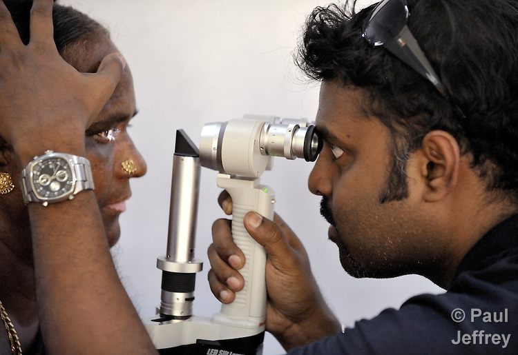Dr. Muraganantham (right) examines a patient at an eye clinic for the poor in Chennai, a city in the southern India state of Tamil Nadu.