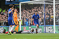 Alvaro Morata of Chelsea (left) celebrates after he scores his team's second goal of the game to make the score 2-1 during the Premier League match between Chelsea and Newcastle United at Stamford Bridge, London, England on 2 December 2017. Photo by David Horn.
