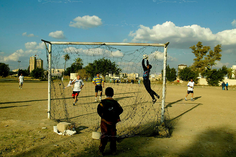 Baghdad, Iraq, Feb 27, 2003.Iraqis LOVE football...before sunset, Baghdad's public parcs are full of enthousiastic friendly competitions.