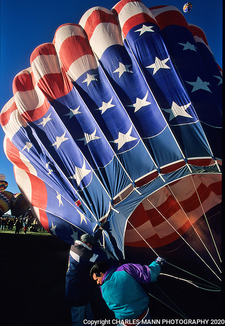 A hot air balloon with an American flag motif gets ready to fly at the Albuquerque International Hot Air Balloon Fiesta.