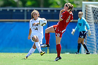 26 September 2010:  FIU's Victoria Miliucci (18) passes the ball despite ASU's Anna Kaloghirou's (8) attempts to block the pass in the first half as the FIU Golden Panthers defeated the Arkansas State Red Wolves, 1-0 in double overtime, at University Park Stadium in Miami, Florida.