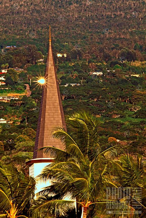 Tall palm trees surround the steeple at Mokuaikaua Church at Kailua-Kona on the Big Island of Hawaii.