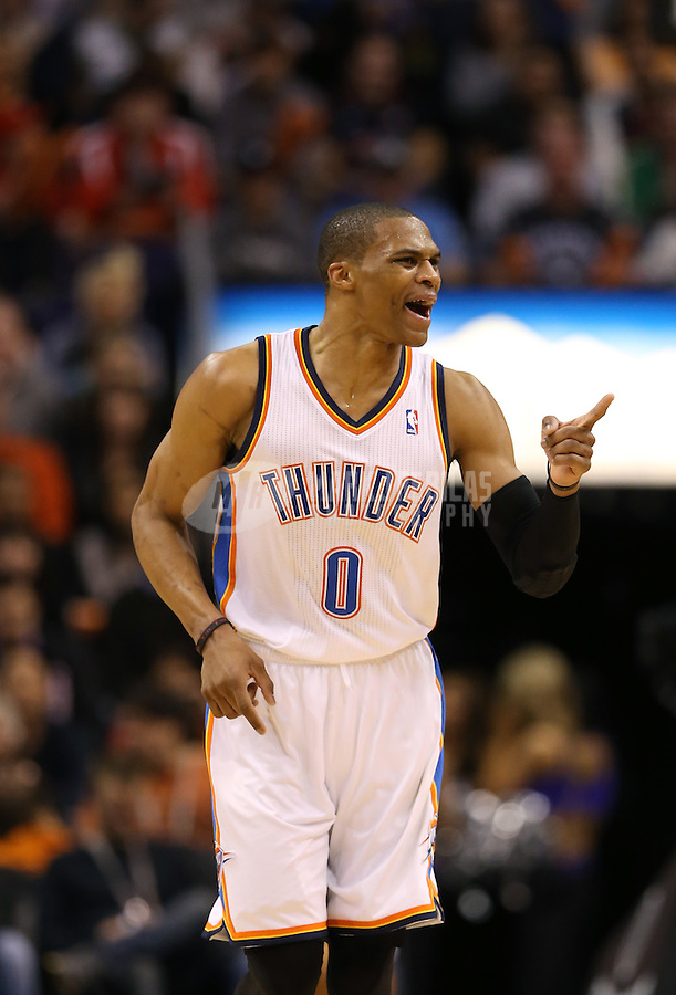 Feb. 10, 2013; Phoenix, AZ, USA: Oklahoma City Thunder guard Russell Westbrook (0) celebrates a score in the third quarter against the Phoenix Suns at the US Airways Center. Mandatory Credit: Mark J. Rebilas-