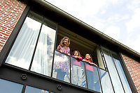 The children of the house look down from the large windows of their bedroom on the top floor of the converted factory