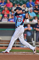 Tennessee Smokies first baseman Dustin Geiger #13 swings at a pitch during a game against the Birmingham Barons at Smokies Park on May 31, 2014 in Kodak, Tennessee. The Barons defeated the Smokies 2-1. (Tony Farlow/Four Seam Images)
