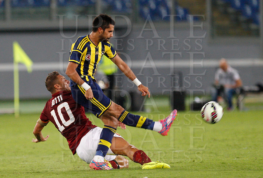 Calcio, amichevole Roma vs Fenerbahce. Roma, stadio Olimpico, 19 agosto 2014.<br /> Roma forward Francesco Totti, left, tackles Fenerbache midfielder Selcuk Sahin during the friendly match between AS Roma and Fenerbahce at Rome's Olympic stadium, 19 August 2014.<br /> UPDATE IMAGES PRESS/Riccardo De Luca