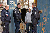 French CRS riot police raid a squat in a disused warehouse in Calais known as the Africa House, used as a shelter by up to 100 African migrants seeking to cross the Channel to the UK.