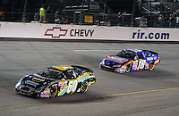 May 1, 2009; Richmond, VA, USA; NASCAR Nationwide Series driver Carl Edwards (60) leads Kyle Busch (18) during the Lipton Tea 250 at the Richmond International Raceway. Mandatory Credit: Mark J. Rebilas-