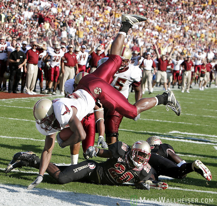 Boston College runningback L.V. Whitworth flips his way into the endzone for a touchdown after FSU cornerbackJamie Robinson (#20) tripped him up at the goaline in the first h alf of their NCAA game at Bobby Bowden Field in Tallahassee, Florida October 21, 2006.    (Mark Wallheiser/TallahasseeStock.com)