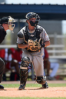GCL Marlins catcher Blake Anderson (26) checks the runner during a game against the GCL Nationals on June 28, 2014 at the Carl Barger Training Complex in Viera, Florida.  GCL Nationals defeated the GCL Marlins 5-0.  (Mike Janes/Four Seam Images)