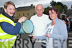 PINT; Pouring out a pint in the old style from a bucket at the Blennerville Trashing Fair on Sunday was Robert O'Sullivan getting the pint were, PJ Dollery and Catherine Tuohy (Tralee)..........