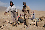 Paghman, Afghanistan; October 24, 2002 -- German-Afghan development cooperation / Welthungerhilfe; here, cleaning and rebuilding the underground water and irrigation system (Turpan / Turfan, locally called karez / kariz / qanat); Rural, People,  Infrastructure -- Photo: © HorstWagner.eu
