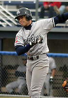 July 11, 2003:  Enrique Cruz of the Staten Island Yankees, Class-A affiliate of the New York Yankees, during a NY-Penn League game at Dwyer Stadium in Batavia, NY.  Photo by:  Mike Janes/Four Seam Images