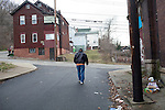 Scenes from Braddock, Pennsylvania. The town, which is known for its steel mills, has lost the majority of its population, as well as its hospital, which was recently torn the down. Many abandoned homes line its streets.