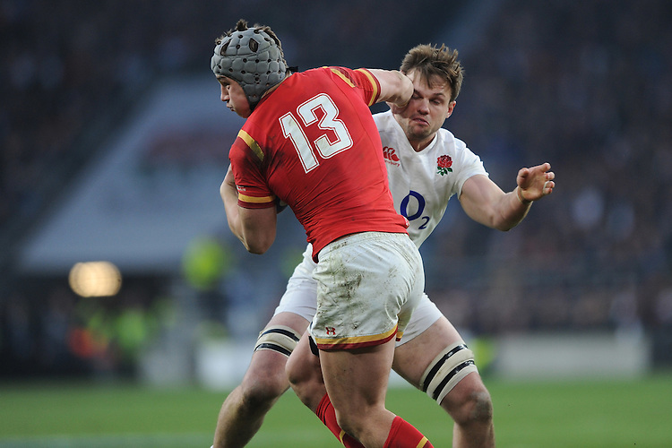 Jonathan Davies of Wales pushes past Jack Clifford of England during the RBS 6 Nations match between England and Wales at Twickenham Stadium on Saturday 12th March 2016 (Photo: Rob Munro/Stewart Communications)