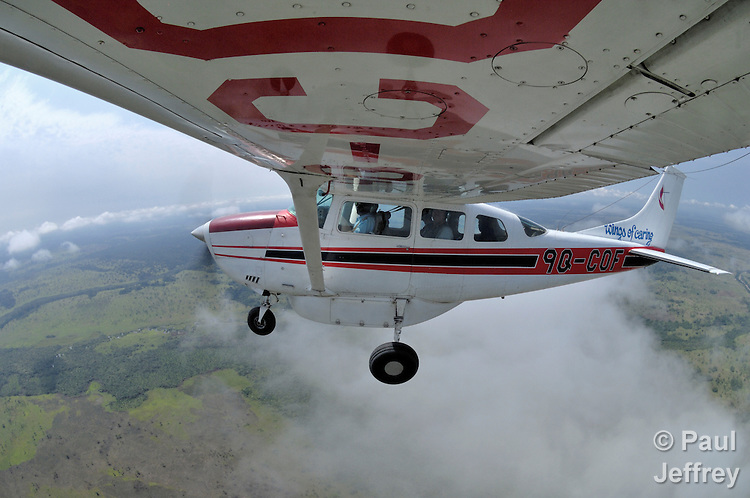 Flying from Tunda to Kananga over the Congo with Jacques Umembudi Akasa, a United Methodist missionary pilot for Wings of Caring Aviation, a program of the United Methodist Church in the Democratic Republic of the Congo. The photograph was made by attaching a camera to the wing and activating the shutter by remote control.