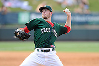 Starting pitcher Daniel McGrath (17) of the Greenville Drive delivers a pitch in a game against the Rome Braves on Sunday, August 3, 2014, at Fluor Field at the West End in Greenville, South Carolina. Rome won, 4-2. (Tom Priddy/Four Seam Images)