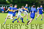 Cordal keeper Sean Óg O'Ciardubhain heading outfield as Renard forwards are bearing down on him, in the Junior Club Football Championship semi final in Beaufort on Sunday.