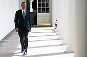 United States President Barack Obama walks along the colonnade of the White House from the residence to the Oval Office to start his day on September 10, 2013 in Washington, DC. <br /> Credit: Kristoffer Tripplaar  / Pool via CNP