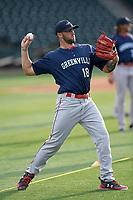 Pitcher Alex Scherff (18) of the Greenville Drive, No. 8  Red Sox prospect and 5th Round draft pick, warms up during a preseason workout on Tuesday, April 3, 2018, at Fluor Field at the West End in Greenville, South Carolina. (Tom Priddy/Four Seam Images)