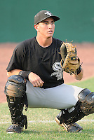 Catcher Martin Medina (12) of the Bristol White Sox, Appalachian League affiliate of the Chicago White Sox, prior to a game against the Elizabethton Twins on August 18, 2011, at Joe O'Brien Field in Elizabethton, Tennessee. Elizabethton defeated Bristol, 13-3. (Tom Priddy/Four Seam Images)