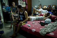 (L-R) Shuki, Tal, Gil, Lital.rest and watch TV together in Shuki's room after a full day of training..(please refer to emailed captions for individual stories).Shuki Rosenweig and Students in training and daily life in Bangkok Thailand on 30th January 2010. .Photo by Suzanne Lee for Chabad Lubavitch