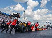 Sep 17, 2017; Concord, NC, USA; Crew members push NHRA top fuel driver Doug Kalitta into position during the Carolina Nationals at zMax Dragway. Mandatory Credit: Mark J. Rebilas-USA TODAY Sports