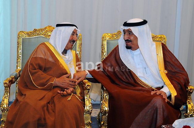 Emir of Kuwait Sheikh Sabah al-Ahmad al-Sabah (L) speaks with Saudi King Salman bin Abdulaziz al-Saud during the 26th Arab Summit in Sharm al-Sheikh, in the South Sinai governorate, south of Cairo, March 28, 2015. Arab League heads of state will hold a two-day summit to discuss a range of conflicts in the region, including Yemen and Libya, as well as the threat posed by Islamic State militants. APAIMAGES/Egyptian Presidency