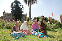 Heba Tallah, Asmaa, Menna and Heba Ahmed of the Noor Family, sit in the campus of Ain Shams University in Cairo, where they study law. Cairo, Egypt. October 9th, 2012.
