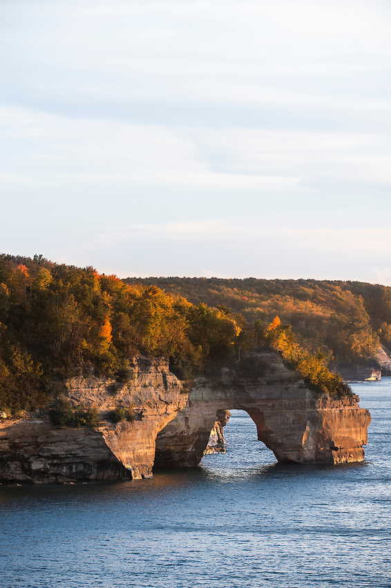 Fall color at the Lovers Leap sea arch of Pictured Rocks National Lakeshore on Michigan's Upper Peninsula.