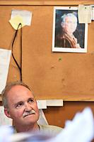 NWA Democrat-Gazette/J.T. WAMPLER T.L. Nelms, owner of the Restaurant on the Corner in Fayetteville sits in his office Wednesday May 17, 2017. On the wall hangs a picture of longtime Dickson Street icon Roger Koetter who operated Rogers Rec from 1954-1986.