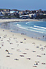 People crowd Bondi Beach on a hot summer day in Sydney, Australia