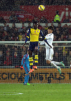 Pictured L-R: Danny Welbeck of Arsenal battles for a header against Ki SUng Yueng of Swansea Sunday 09 November 2014<br />