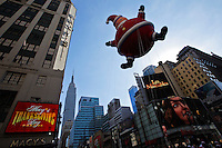 People take part of the annual Thanksgiving day parade as the Empire State Building is seen on the skyline in New York, November 22, 2012. . Photo by Eduardo Munoz Alvarez / VIEWpress