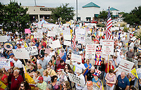 Supporters of the Tea Party Express, a traveling national bus tour of people against higher government spending, higher taxes, and President Obama's push to reform health care, hold a rally at the Cape Buffalo Grille in Dallas, Texas, Friday, September 4, 2009. The Tea Party Express is heading to Washington, DC where it will hold a final rally and march...MATT NAGER/ SPECIAL CONTRIBUTOR