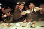 "Farmers enjoy a drink of tea and whisky at the Farmers ""Christmas Market"", Knighton, Shropshire Circa 1985. part of Knighton is in Wales."