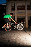 PHILIPPINES, Palawan, Puerto Princesa, boy does tricks on his bike in Central Puerto Princessa near the Mitra Amphitheater