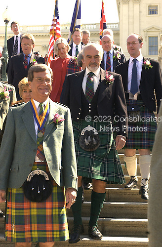 United States Senate Majority Leader Trent Lott (Republican of Mississippi), left, leads actor Sir Sean Connery down the steps of the U.S. Capitol Building.  Connery was at The Capitol to receive the American-Scottish Foundation's William Wallace Award as part of the National Tartan Day Capitol Ceremony on April 5, 2001..Credit: Ron Sachs / CNP