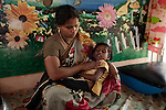 CHENNAI, INDIA, JULY 2012: A mother is holding her daughter in the leisure center of terre des home.,july 2012. Female infanticide is the intentional killing of baby girls due to the preference for male babies and from the low value associated with the birth of females.In rural India, the centuries-old practice of female infanticide can still be considered a wise course of action© Giulio Di Sturco
