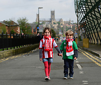 Two young Lincoln City fans arrive at the ground<br /> <br /> Photographer Chris Vaughan/CameraSport<br /> <br /> Vanarama National League - Lincoln City v Macclesfield Town - Saturday 22nd April 2017 - Sincil Bank - Lincoln<br /> <br /> World Copyright &copy; 2017 CameraSport. All rights reserved. 43 Linden Ave. Countesthorpe. Leicester. England. LE8 5PG - Tel: +44 (0) 116 277 4147 - admin@camerasport.com - www.camerasport.com