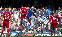 Jose Holebas of Watford & Willian of Chelsea go up for the ball during the Premier League match between Chelsea and Watford at Stamford Bridge, London, England on 21 October 2017. Photo by Andy Rowland.