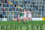 M Devlin breaks through the tackles of the PS Corcha Dhuibhne in the semi final in Fitzgerald Stadium on Sunday