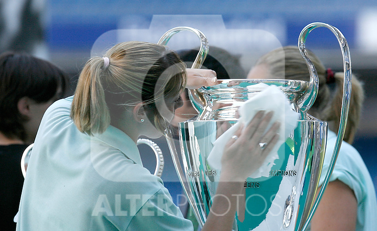 An employee cleans up the trophy of the Champions League before Real Madrid's new player Kaka official presentation. June 30, 2009. (ALTERPHOTOS/Alvaro Hernandez)